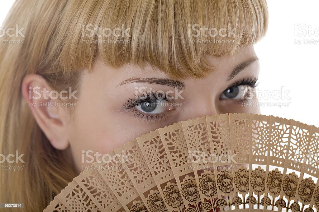 blonde with a fan royalty-free stock photo