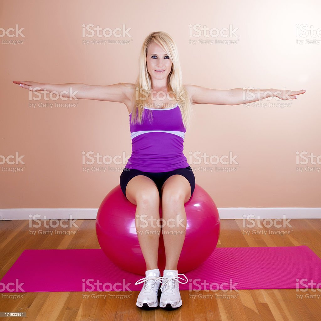 Blonde with a fitness ball royalty-free stock photo