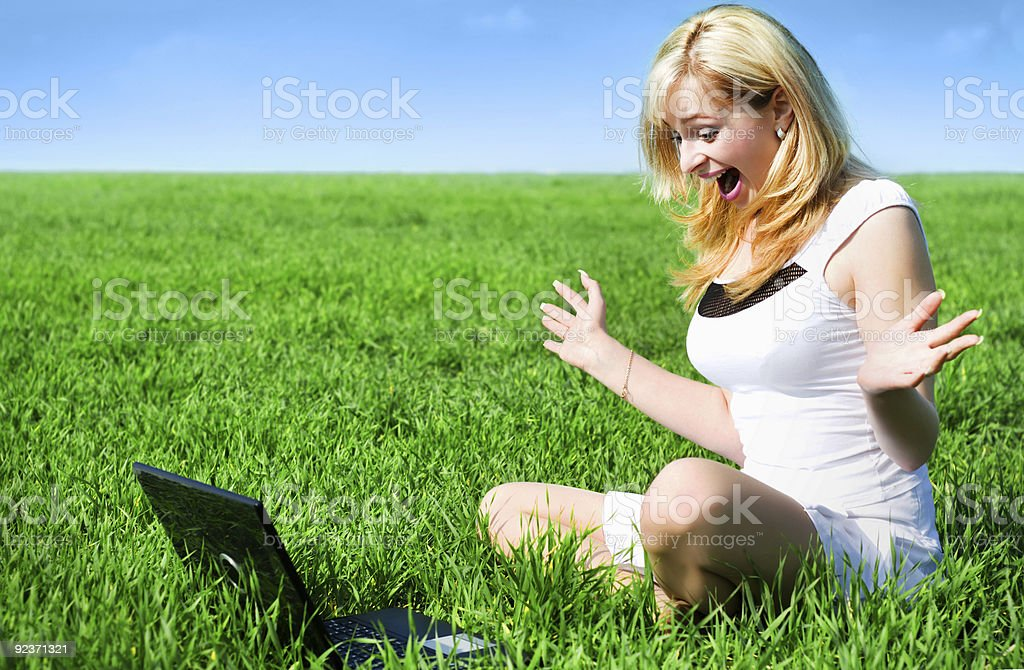 Blonde with a laptop royalty-free stock photo