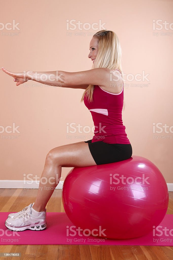 Blonde with a Pink Pilates Ball royalty-free stock photo