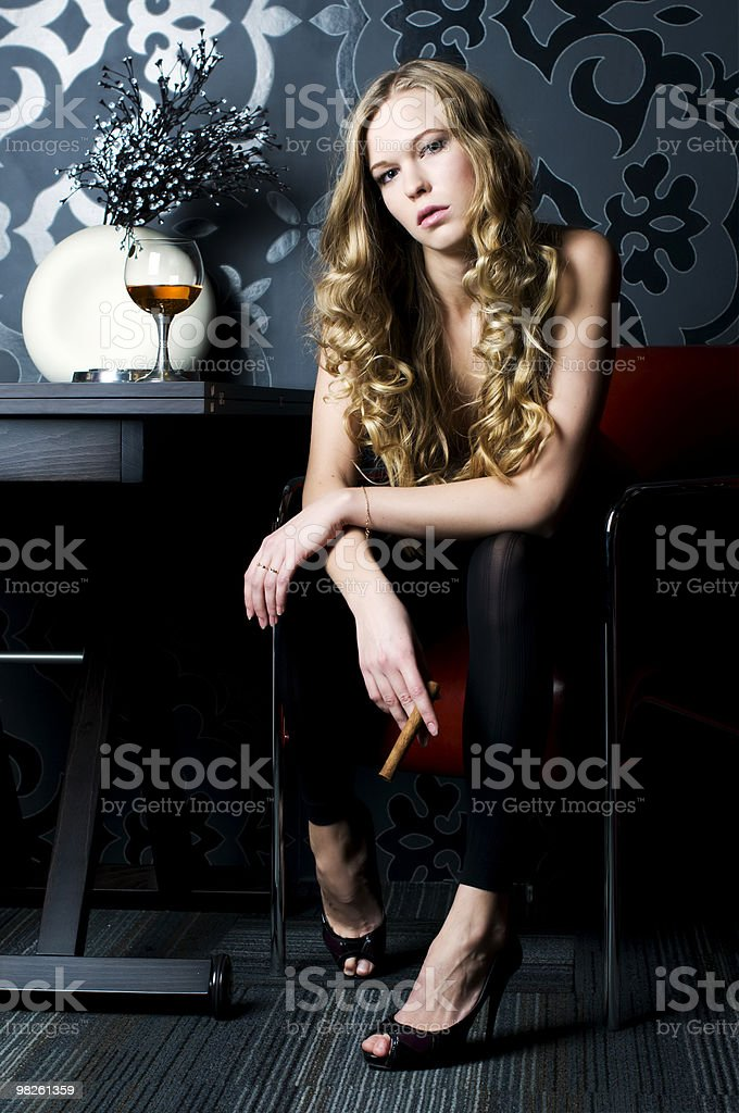 Blonde with cigar royalty-free stock photo