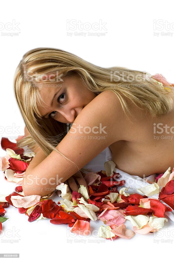 blonde with flower petals and madonna lily royalty free stockfoto