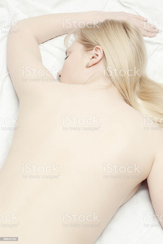 blonde with naked back lying royalty-free stock photo
