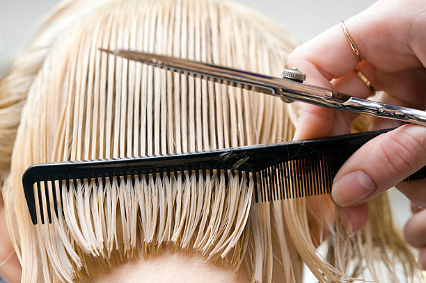 Blonde woman at hair saloon  short hair stock pictures, royalty-free photos & images