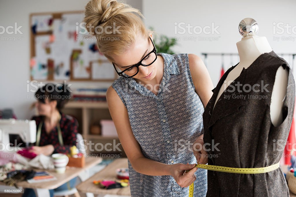 Blonde woman creating with big care stock photo