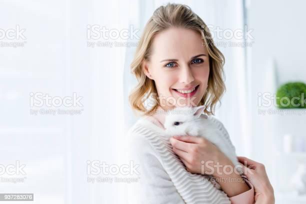Blonde woman cuddling white bunny by window picture id937283076?b=1&k=6&m=937283076&s=612x612&h=aawqog4qo0hjpu6e5rpjql10piakixyuyljowwu ikw=