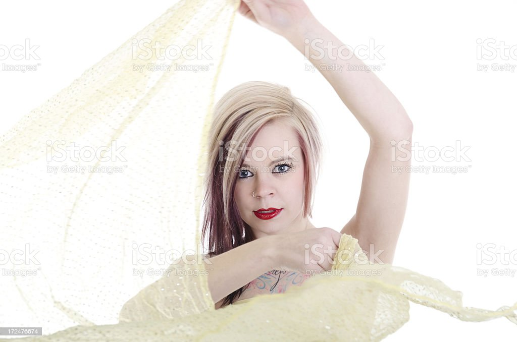 Blonde woman doing scarf move in bellydance. royalty-free stock photo