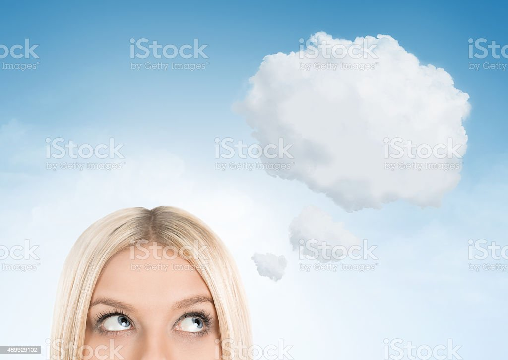 Blonde woman dreaming stock photo