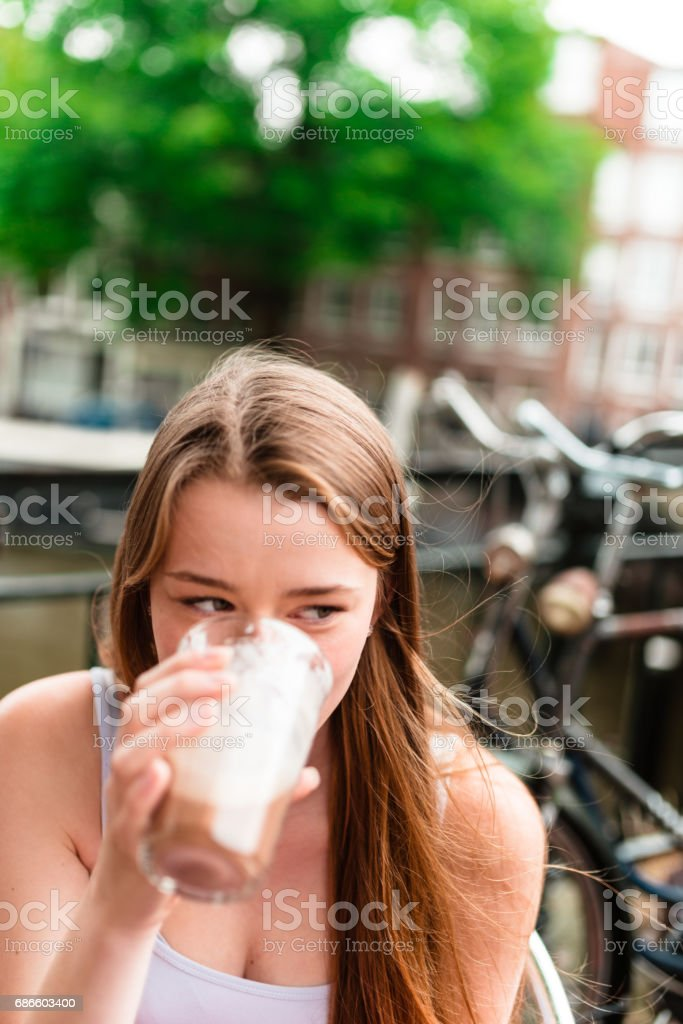 Blonde woman drink a cappuccino at the cafe royalty-free stock photo
