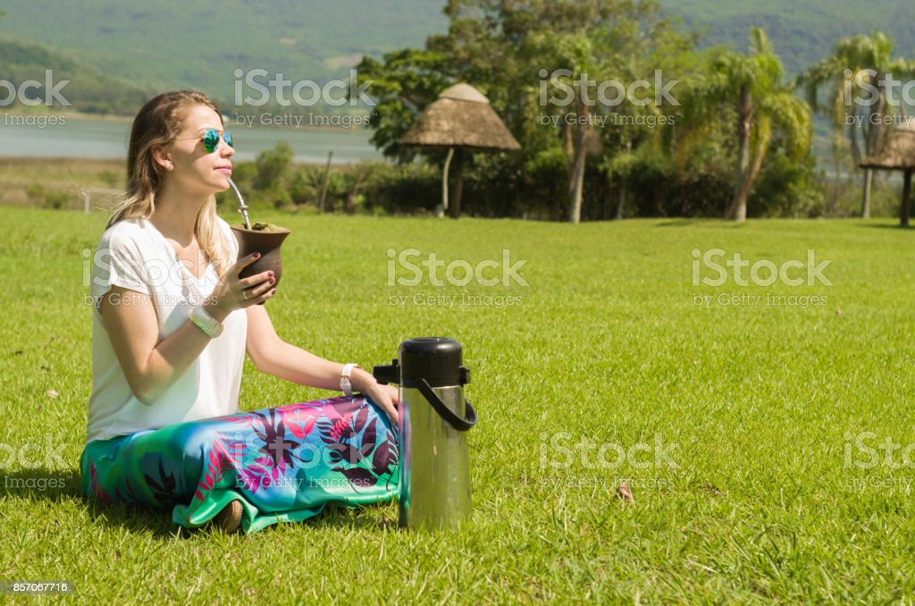 Blonde woman drinking the traditional Chimarrão stock photo