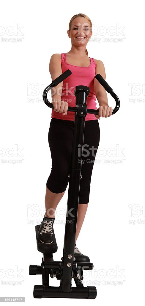 Blonde Woman Exercising on a Stepper royalty-free stock photo