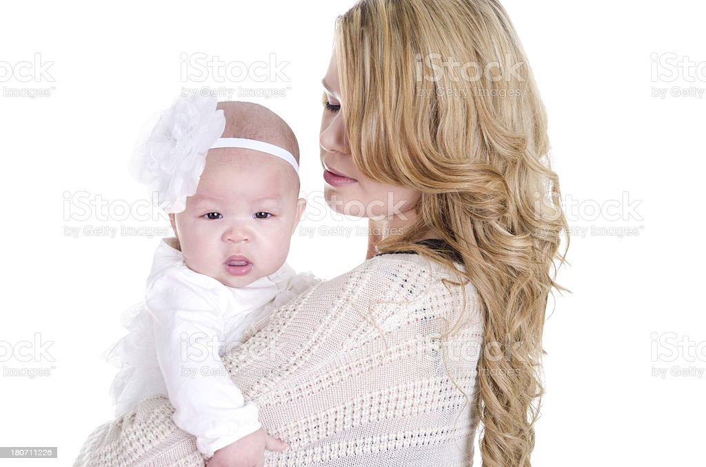Blonde woman holding 4.5 month old baby girl. royalty-free stock photo