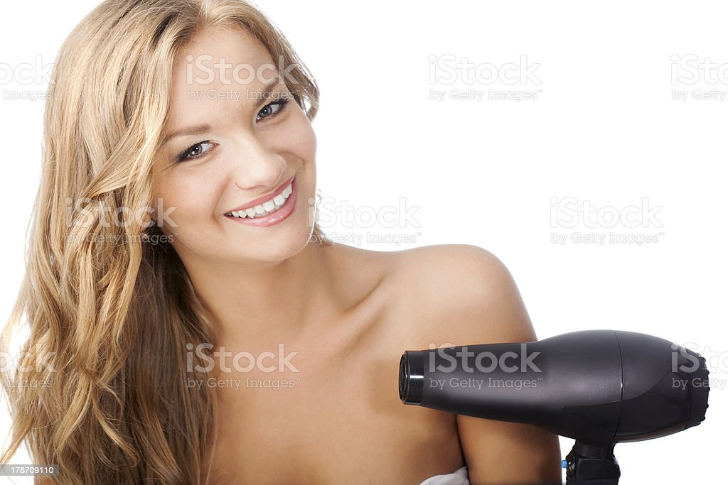 blonde woman holding hairdryer royalty-free stock photo