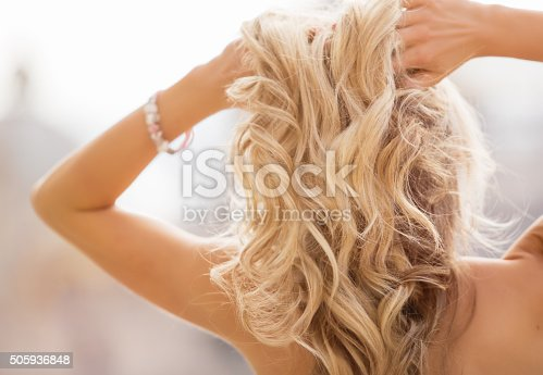 istock Blonde woman holding her hands in hair 505936848