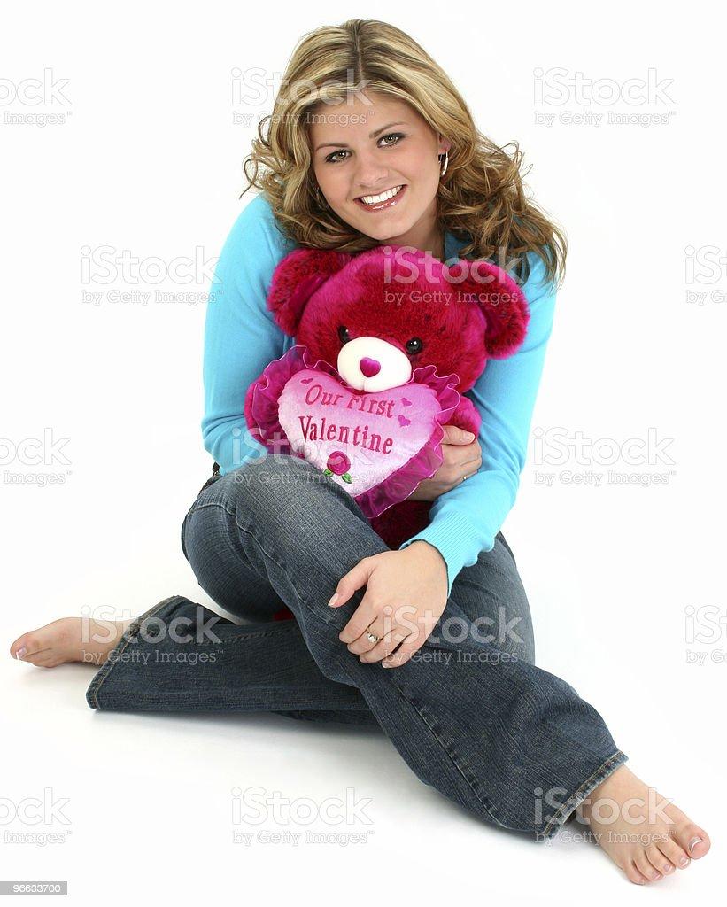 Blonde Woman Hugging Bear royalty-free stock photo