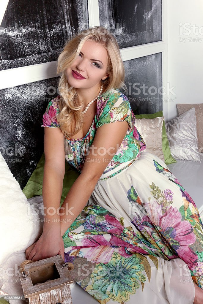 Blonde woman in beautiful dress christmas time stock photo