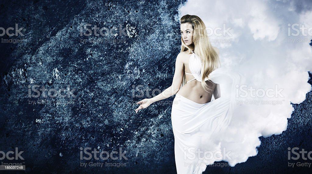 Blonde Woman in Cloud Dress at Grunge Blue Wall stock photo