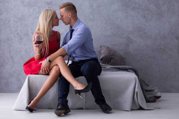 Blonde woman in high heels with man stock photo