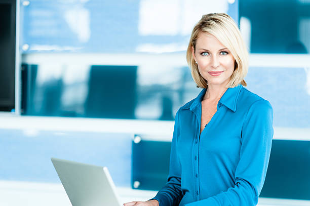 Blonde Woman in Modern Home Office stock photo