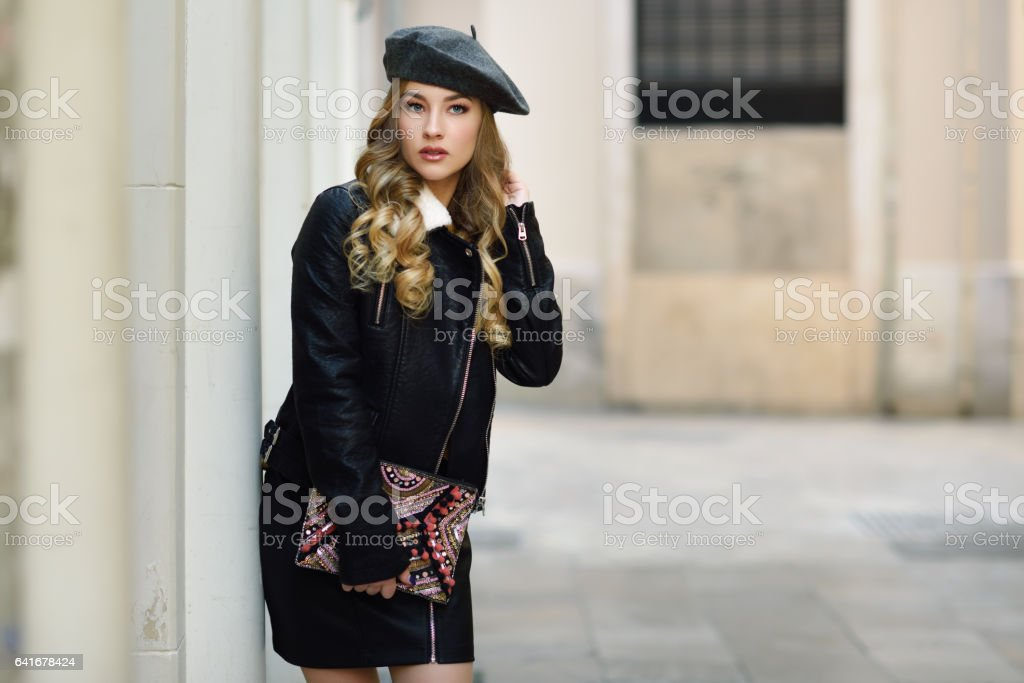 Blonde woman in urban background. stock photo