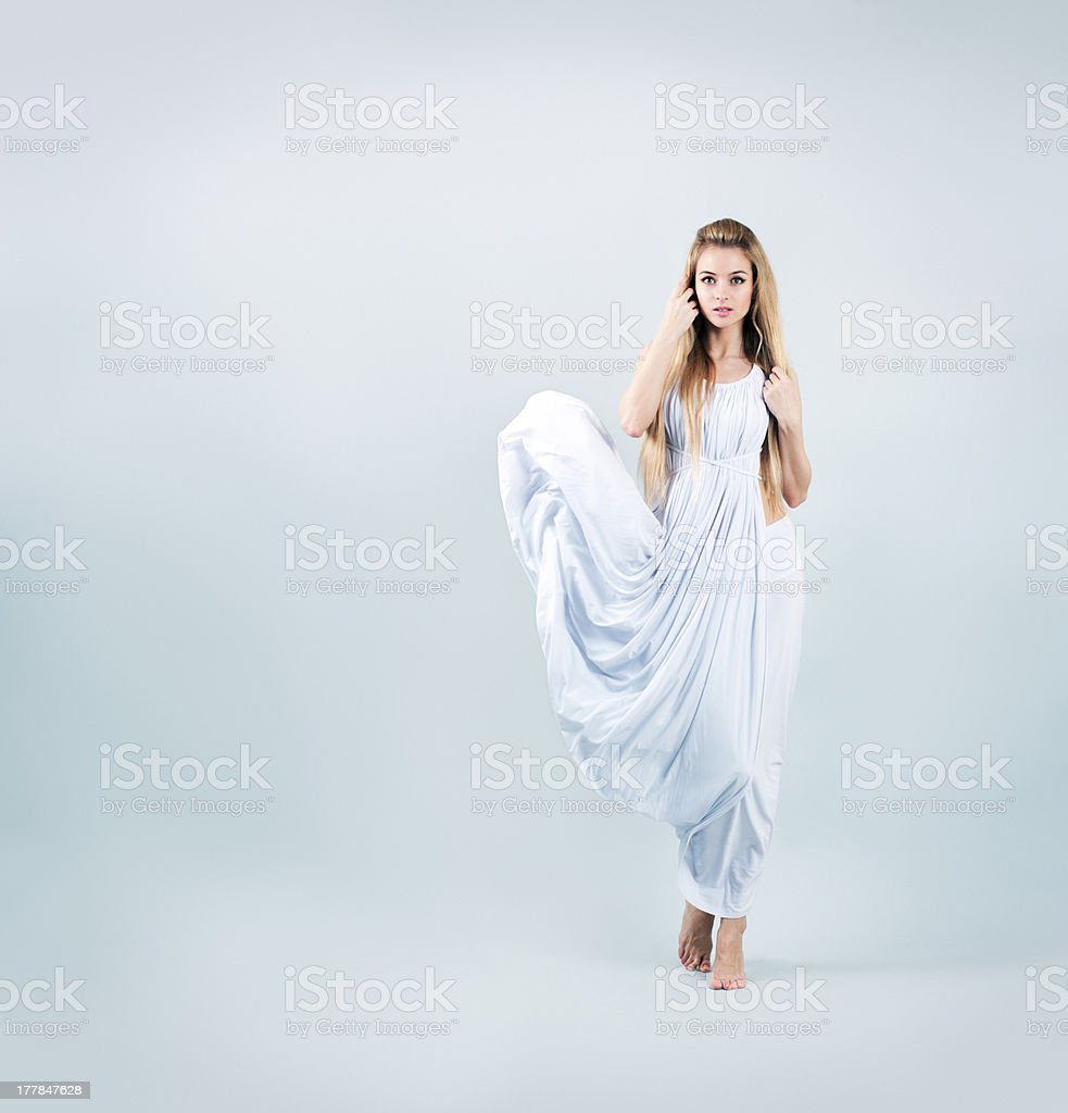 Blonde Woman in Waving White Dress stock photo