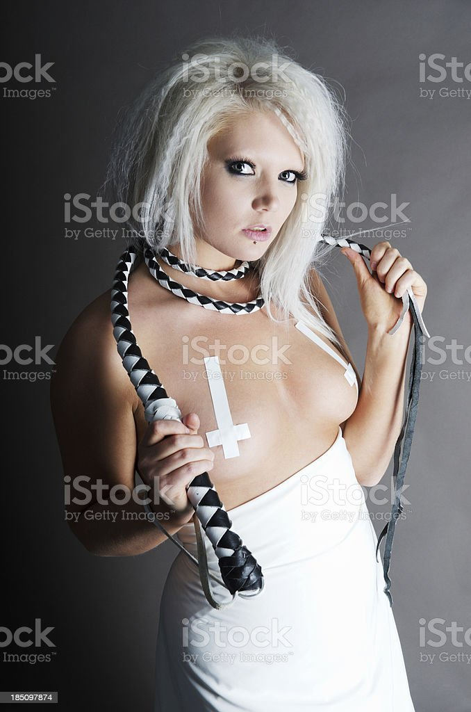 Blonde woman in white with whip around neck. royalty-free stock photo