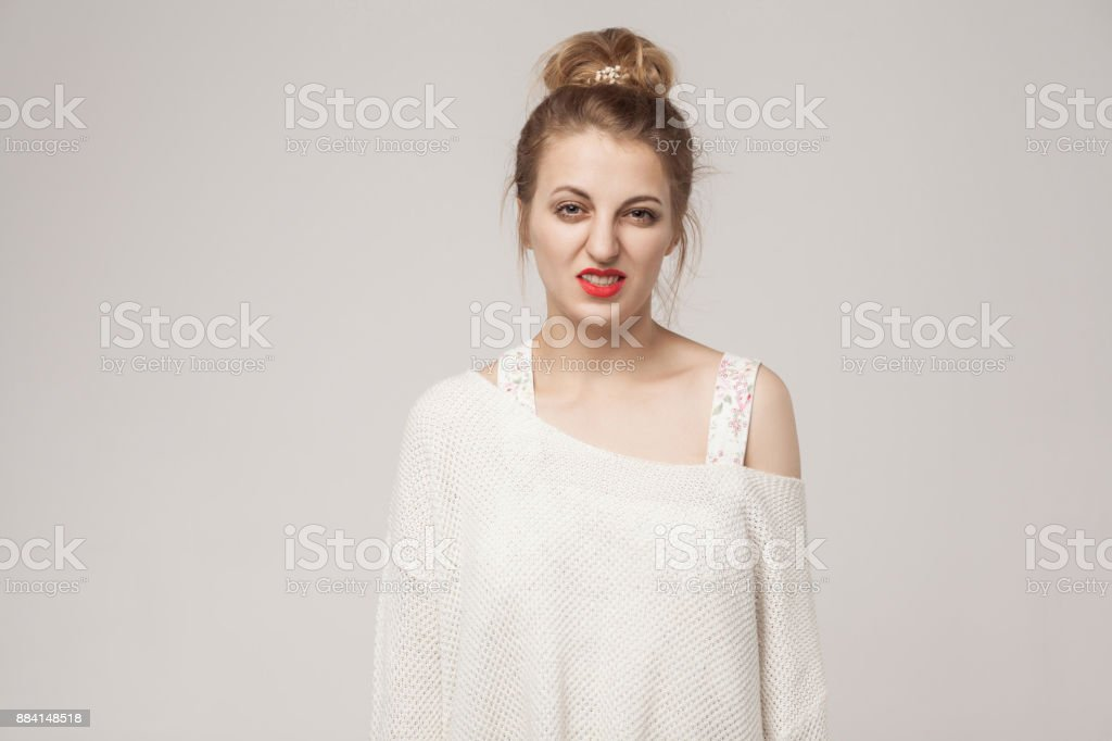 Blonde woman looking at camera with disgust stock photo