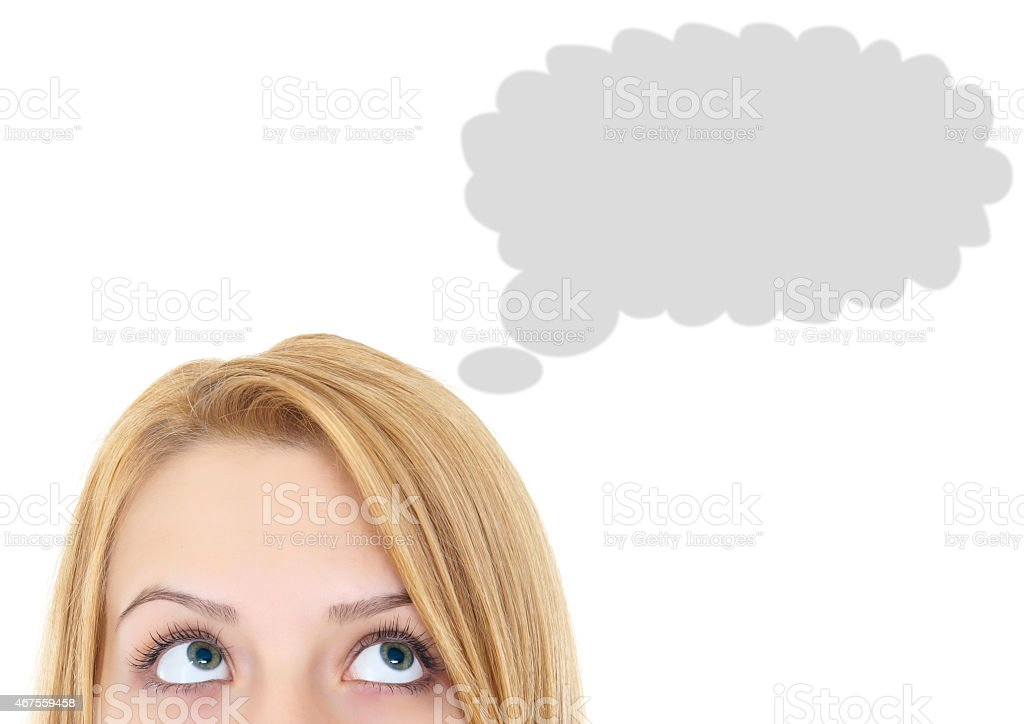 Blonde woman looking up at grey thought cloud on white back stock photo
