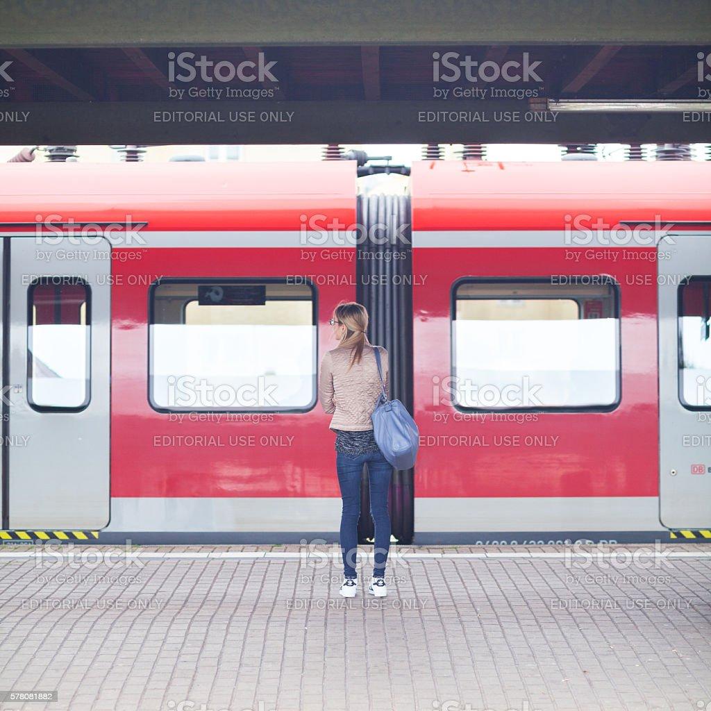 Blonde woman on platform stock photo