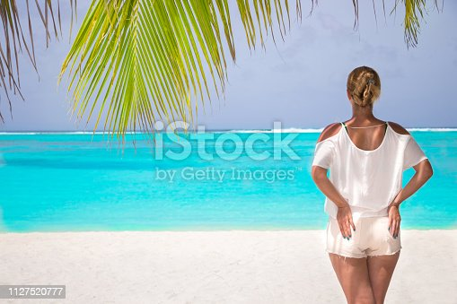 883117662 istock photo Blonde woman on the tropical beach 1127520777