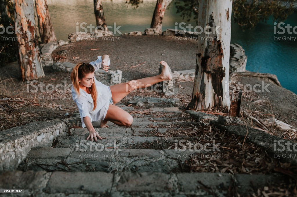 Blonde woman performing contemporary dance in nature royalty-free stock photo