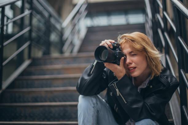 Blonde woman photographer sitting on steps in city picture id1128229769?b=1&k=6&m=1128229769&s=612x612&w=0&h=yogpddabx4q2q9egcimohtxox1izwmxiyiqjnht3wuk=