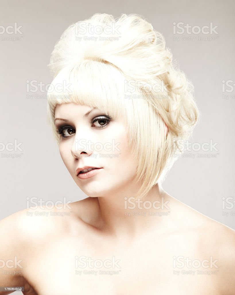 Blonde Woman Posing for Camera royalty-free stock photo