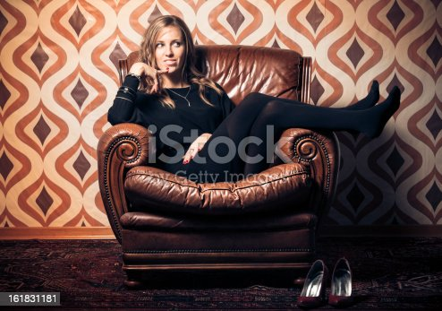 istock Blonde Woman Relaxing on Vintage Armchair 161831181