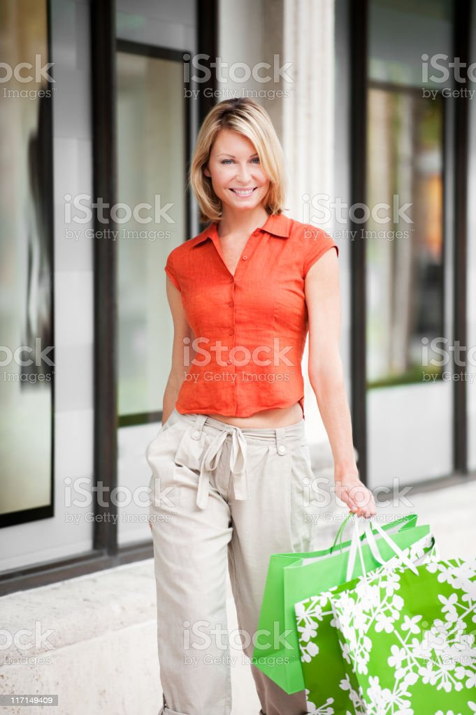 Blonde Woman Shopping with Bags royalty-free stock photo