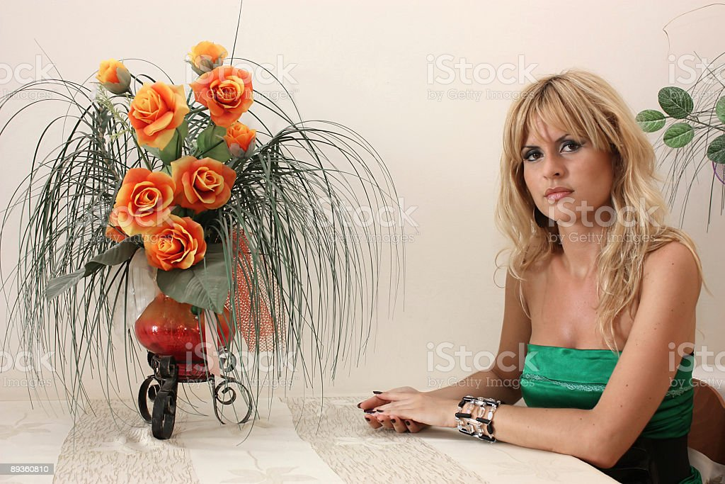 Blonde woman sitting at the table royalty-free stock photo
