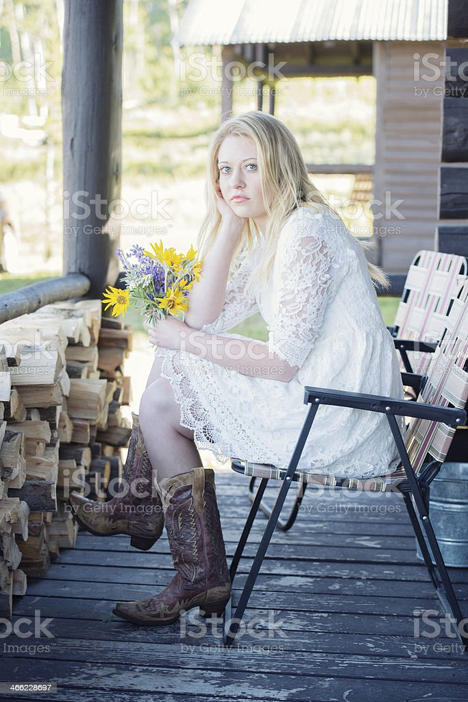 Blonde Woman Sitting on the Porch royalty-free stock photo
