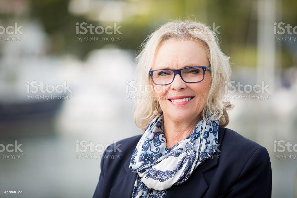 Blonde woman smiling stock photo