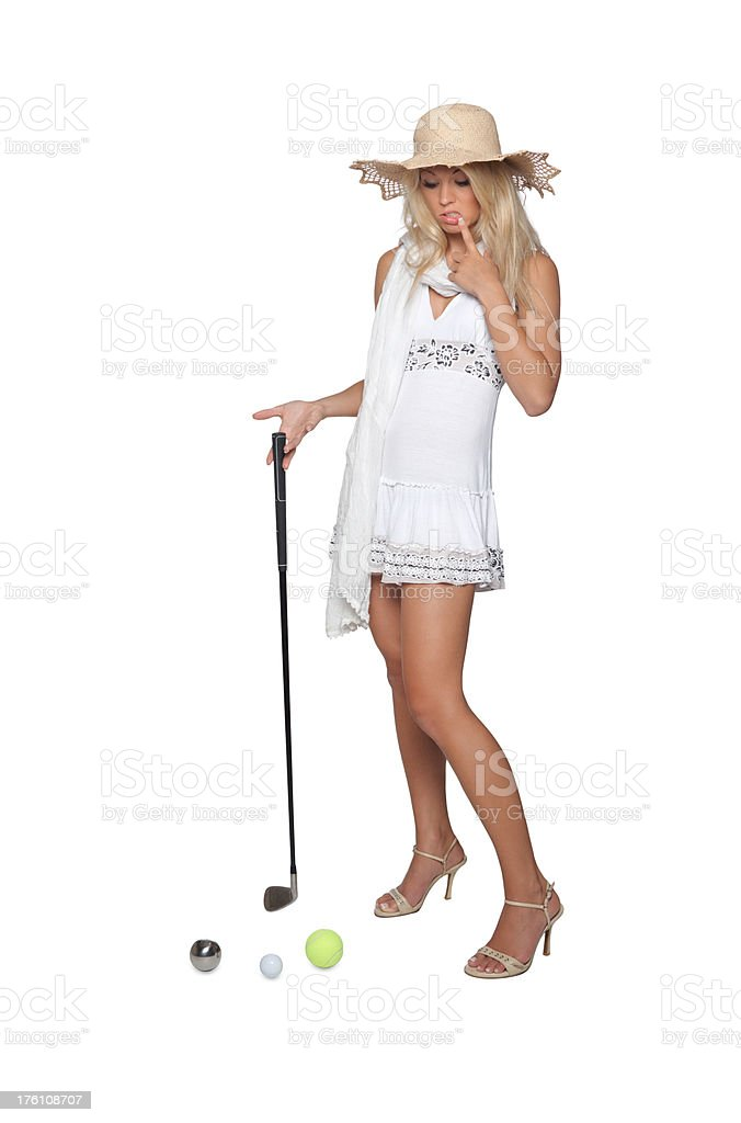 blonde woman trying to play golf royalty-free stock photo