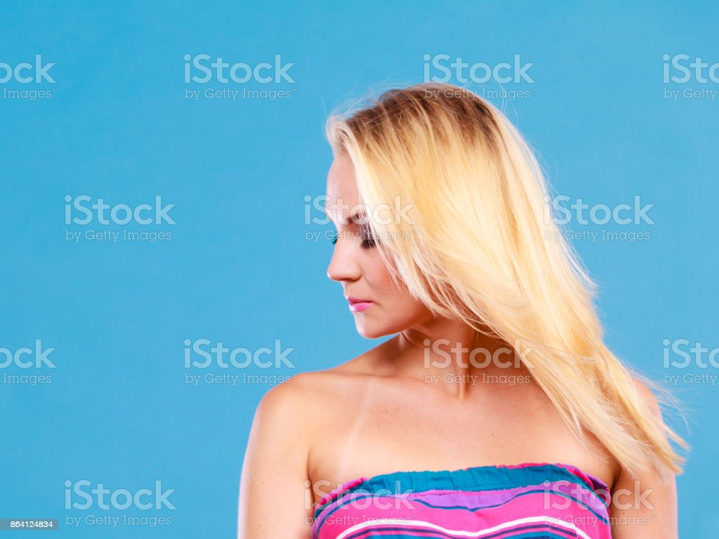 Blonde woman wearing colorful striped strapless shirt royalty-free stock photo