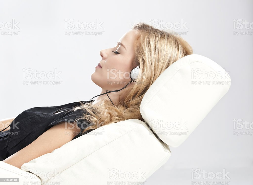 Blonde woman with headphones royalty-free stock photo