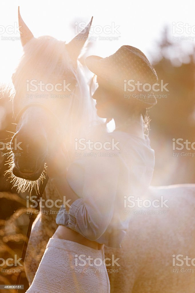 Blonde woman with horse royalty-free stock photo