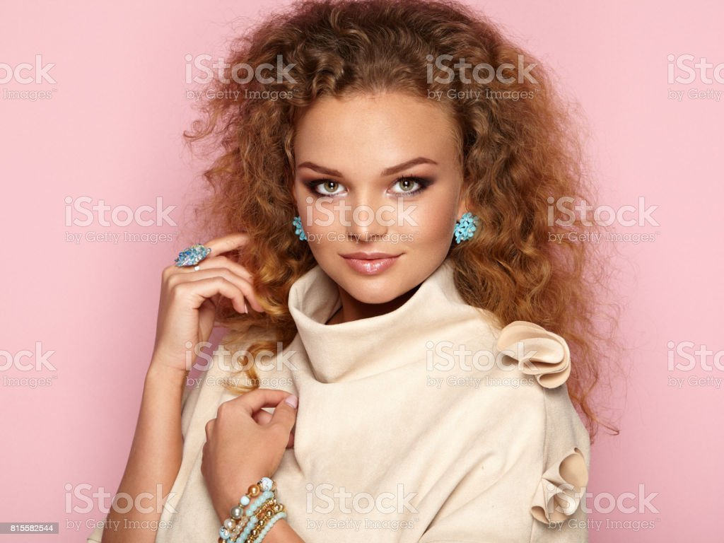 Blonde woman with long and shiny curly hair stock photo