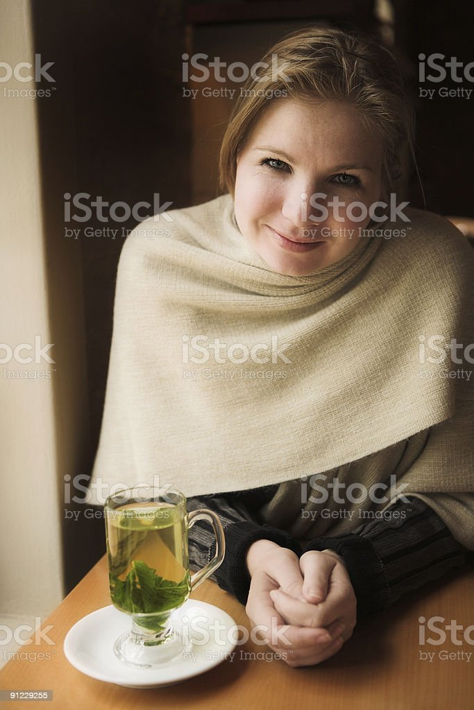 Blonde woman with mint tea royalty-free stock photo