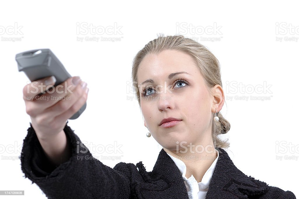 Blonde woman with remote control royalty-free stock photo