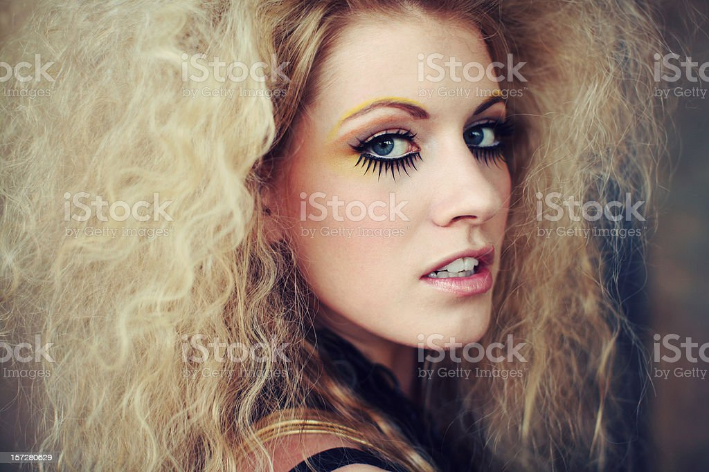 Blonde Woman with Yellow Eyeshadow and Pink Lipstick royalty-free stock photo