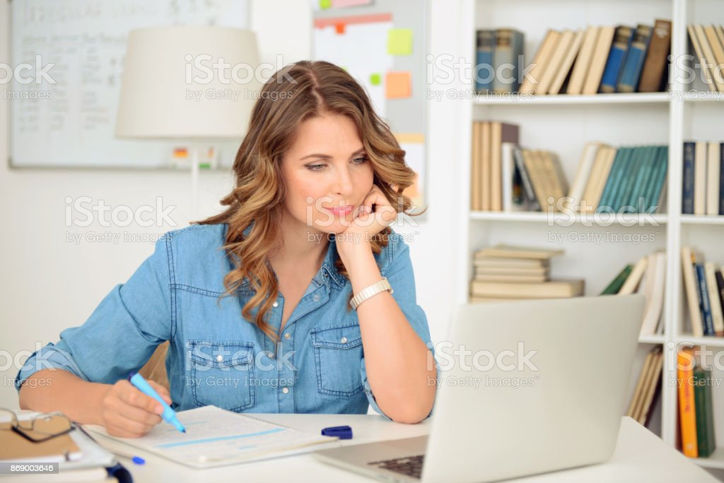 blonde woman working in the office stock photo