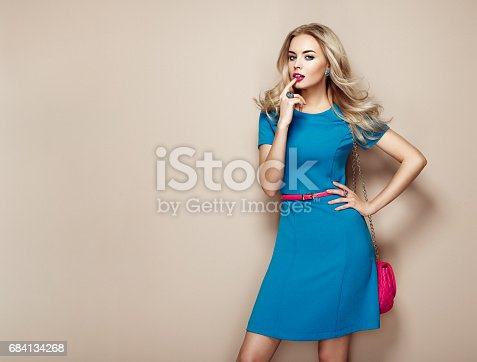 istock Blonde young woman in elegant blue summer dress 684134268