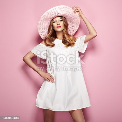 istock Blonde young woman in elegant white dress 646840434