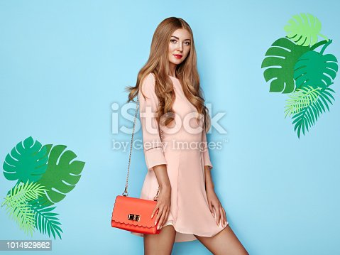 1078252326 istock photo Blonde young woman in floral spring summer dress 1014929862